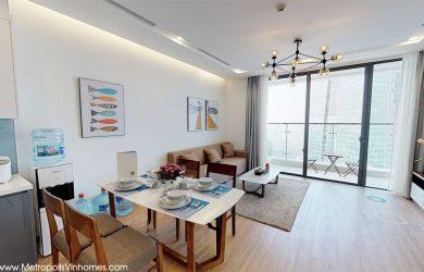 Bàn ăn + Sofa tại phòng khách căn hộ Metropolis M1 cho thuê.